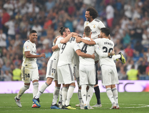 Karim Benzema (#9) of Real Madrid celebrates with teammates after scoring his teams second goal during the La Liga match between Real Madrid CF and CD Leganes at Estadio Santiago Bernabeu on September 1, 2018 in Madrid, Spain. (Aug. 31, 2018 - Source: Denis Doyle/Getty Images Europe)