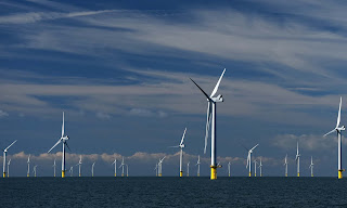 A wind farm off the coast of Sussex. (Photograph Credit: Mike Hewitt/Getty Images) Click to Enlarge.