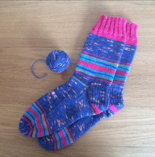 Blue and pink hand-knit socks