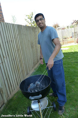 Man with his new barbecue