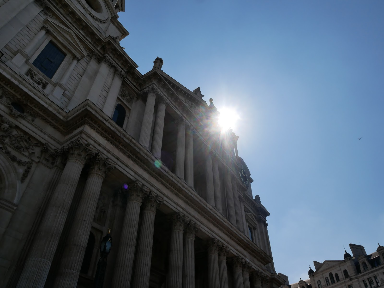 The sun beating down on the front of St. Paul's Cathedral, London
