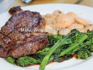The Niman Ranch ribeye steak with Greek Gigante beans, sautéed rapini and topped with a Zinfandel sauce at the Harvest Moon Cafe