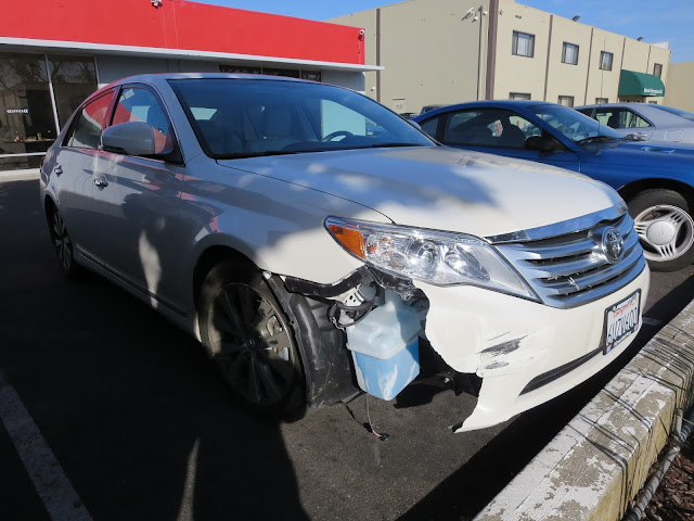 2012 Toyota Avalon with collision damage before repairs at Almost Everything Auto Body