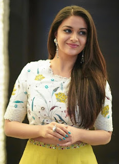 Keerthy Suresh in White Dress with Cute and Chubby Cheeks Smile 3