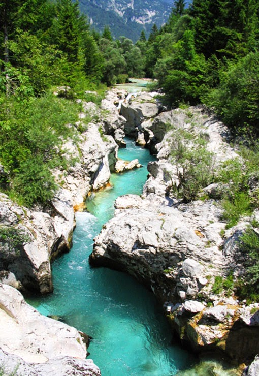 The Soča other names Friulian: Lusinç, archaic German: Sontig, An Alpine river in character, its source lies in the Trenta Valley in the Julian Alps in northwestern Slovenia, at an elevation of 876 metres .The river runs past the towns of Bovec, Kobarid, Tolmin, Kanal ob Soči, Nova Gorica (where it is crosse