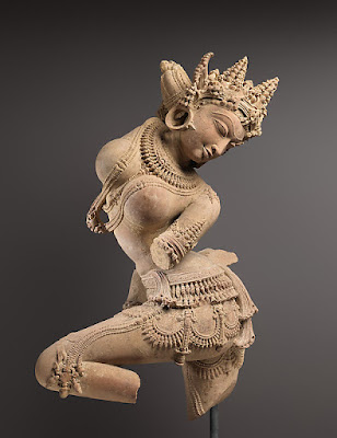dancing female figure