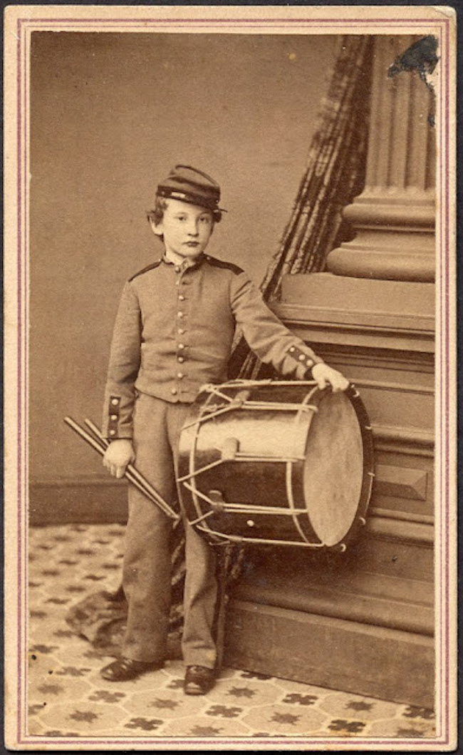 Sepia photo of a young drummer boy. American Civil War. Situation Normal, and other stories of The Better Defense. marchmatron.com