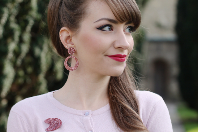 Bow and Crossbones pink glitter Vivien earrings and Matilda atomic brooch