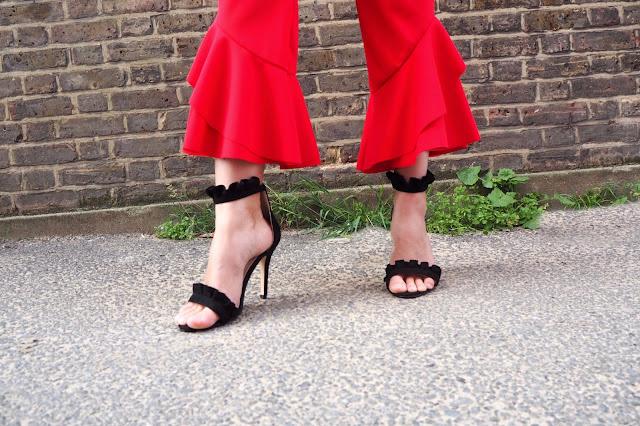 Black frilly heels