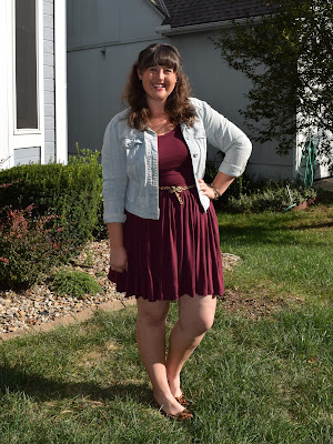 an outfit with a red dress, denim jacket, and leopard accessories