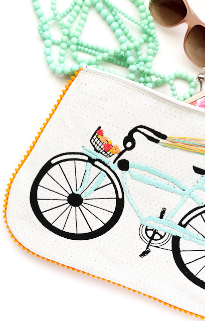 DIY Embroidered Bike Pom Pom Clutch with Tassel Zipper - Learn how to sew a clutch - how to sew and bag - zippered bag tutorial - clutch tutorial - DIY Summer Accessories