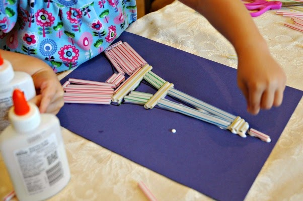 gluing straws on eiffel tower outline