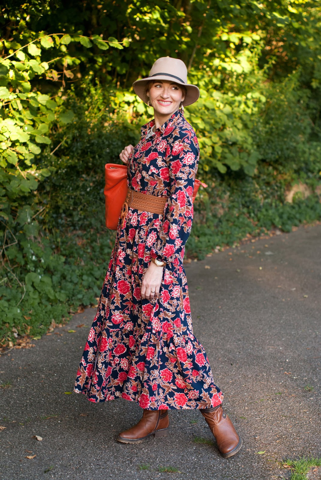 Romantic, Ralph Lauren-inspired 70s style autumn/fall outfit: Floral maxi dress tan belt and boots camel fedora orange leather tote bag | Not Dressed As Lamb, over 40 style