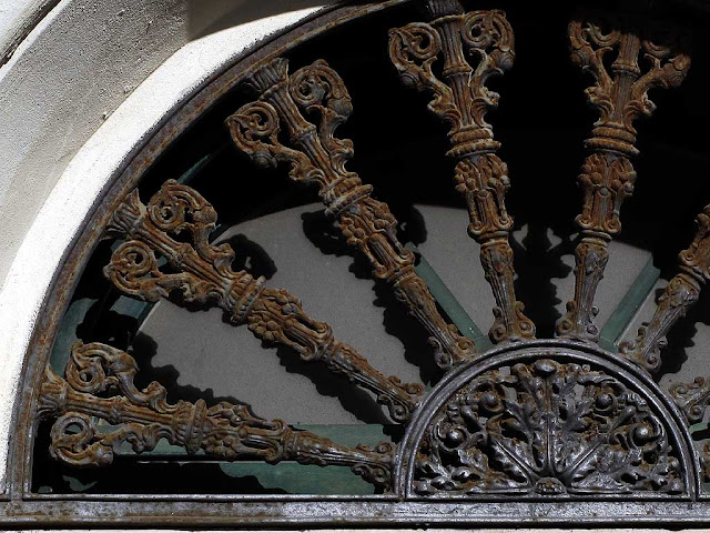 Detail of the fanlight window above a front door in, Livorno