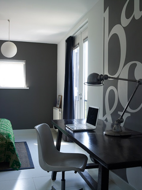 Setting for Four: Black desk area with cool stencilled wall