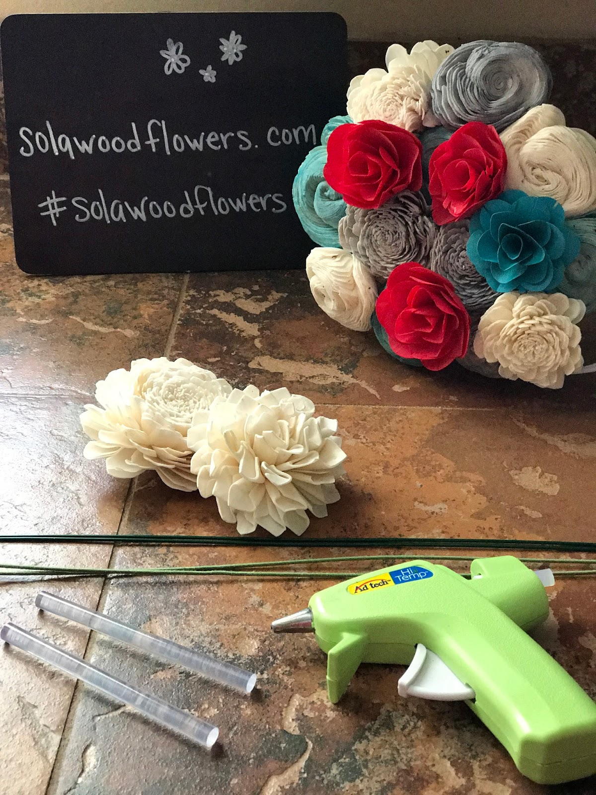 Sola Wood Flowers Blog: Putting a wire stem on a sola wood flower.
