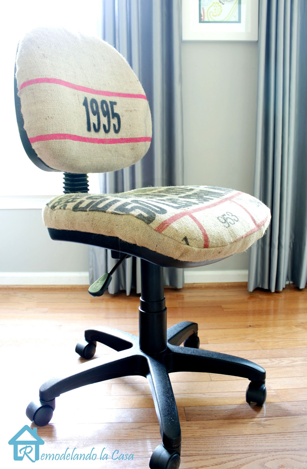 a burlap coffee sack is used to upholster an office chair.
