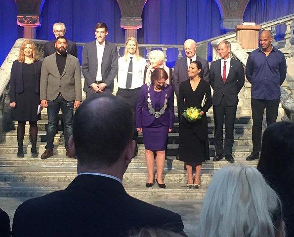 Crown Princess Victoria wore Dagmar Classic Ruffle V-Neck Black Dress and L.K. Bennett Lack Pumps at 2017 Stockholm Peace