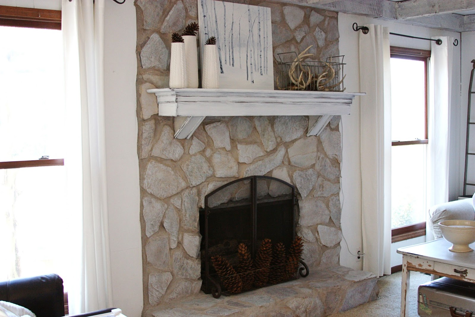 Stone fireplace with distressed window picture frame ...