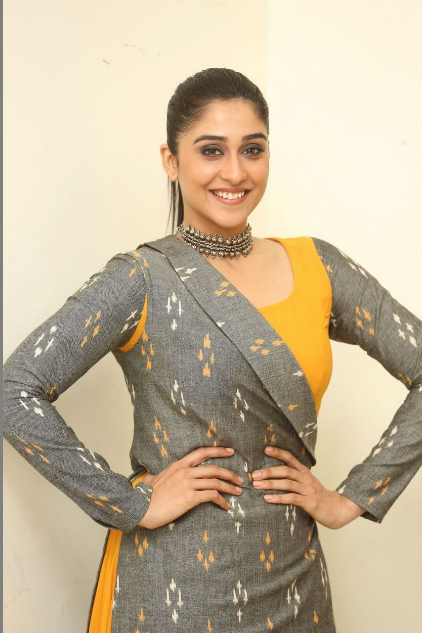 Tollywood Actress Regina Cassandra Hot Long Hair Style  Ponytail In Yellow Dress
