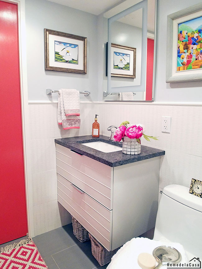 small bathroom with floating Ikea vanity and flush mounted medicine cabinet