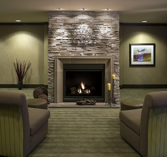 Fireplace mantels as a center point in the Interior Design of a room  House Interior Decoration