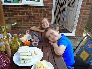 Top Ender and Dan Jon Jr having a Summer Tea Party in the Garden