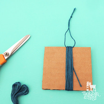 How to make a tassel tutorial, step 2, tie knot at top to create a loop