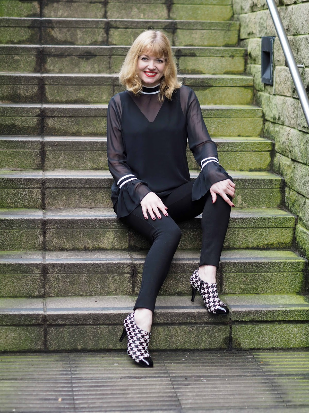 black and white tipped blouse with bell sleeves, black and white hounds tooth shoe boots