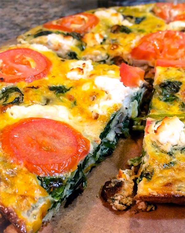 Take a cheese and spinach frittata. Add tomato slices and mushrooms. Yum!