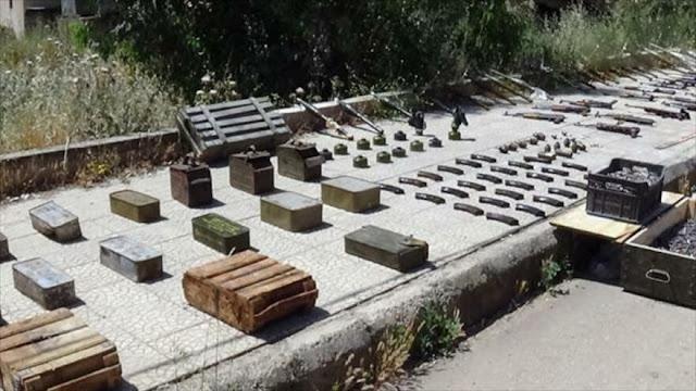 Siria halla armas y municiones dejadas por terroristas en Daraa