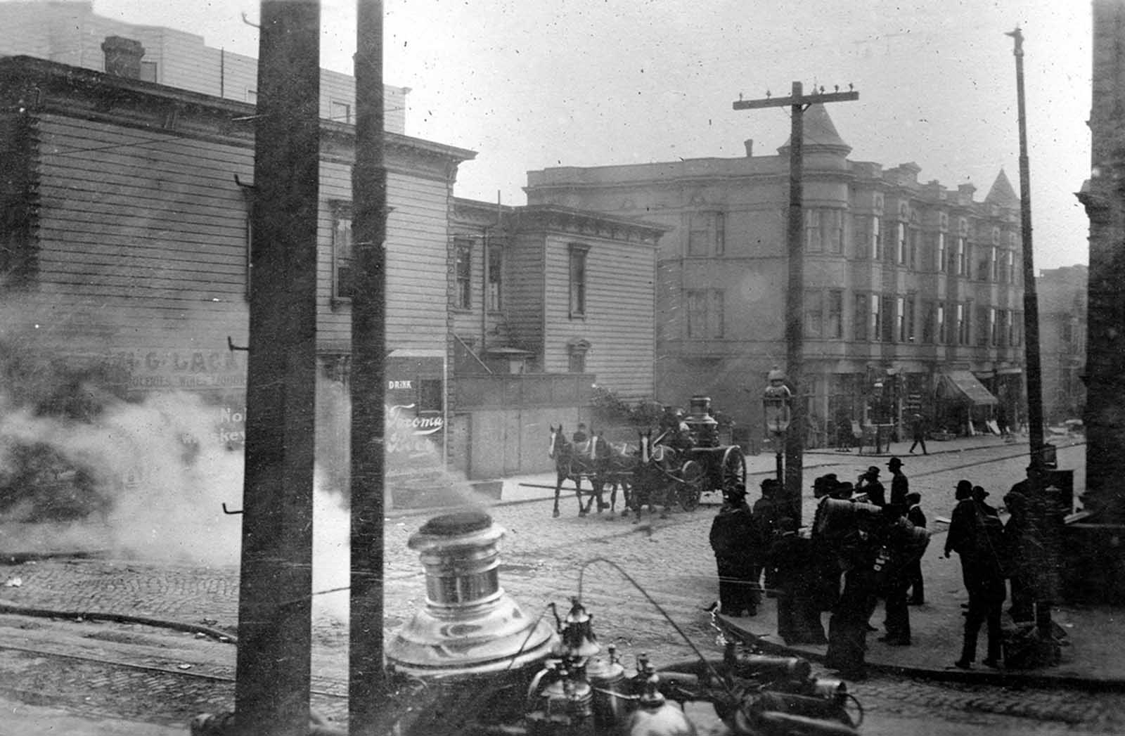 A horse-drawn fire engine retires from a fire to move to a new location on April 19, 1906.