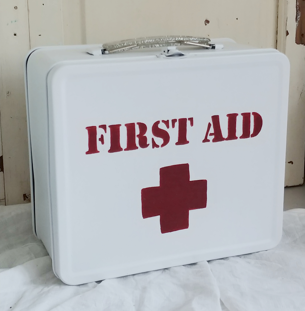 first aid kit from a lunch pail