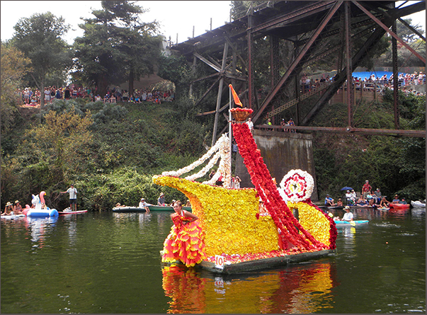 Yellow boat with red and white, begonia-dress-clad human figurehead