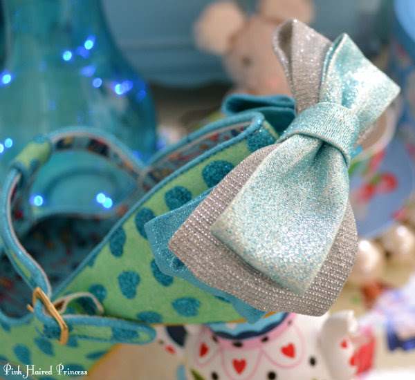 blue and silver glitter bows on heel of shoes