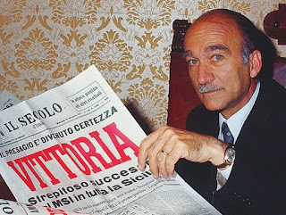 Giorgio Almirante in 1971, reading about his party's success in regional elections in Sicily