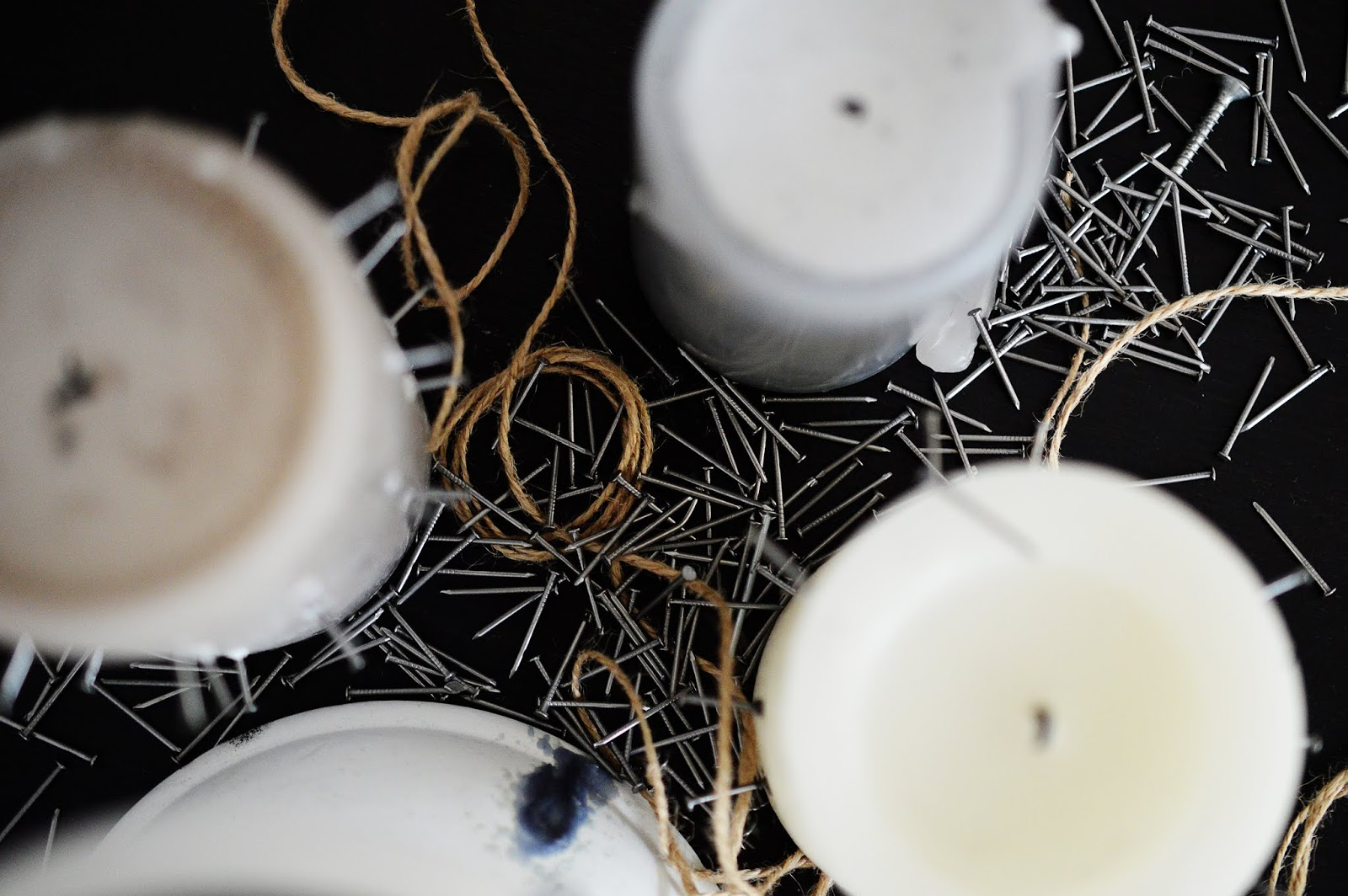 candles photographed from above with needles coming out from the sides