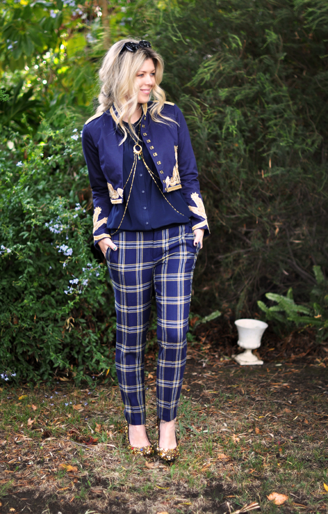plaid pants, navy jacket with gold embroidery