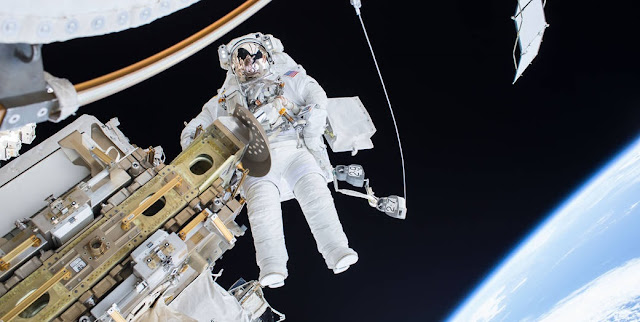 Expedition 46 Flight Engineer Tim Kopra on a Dec. 21, 2015 spacewalk, in which Kopra and Expedition 46 Commander Scott Kelly successfully moved the International Space Station's mobile transporter rail car ahead of Wednesday's docking of a Russian cargo supply spacecraft. Credit: NASA