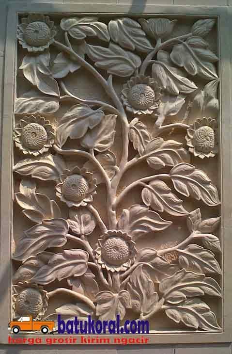 relief ukir motif bunga matahari