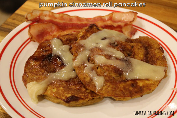 Pumpkin Cinnamon Roll Pancakes // Pancakes have never been better with a good helping of pumpkin and cinnamon sugar swirl #breakfast #pumpkin #recipe #pancakes