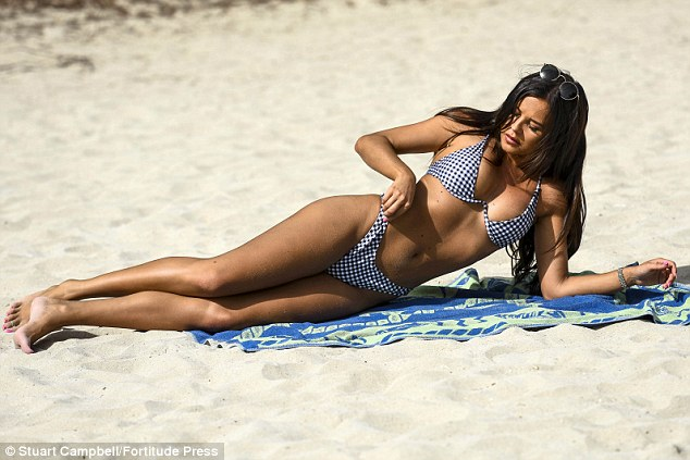 TOWIE's Shelby Tribble shows-off her trim physique in skimpy bikini as she enjoys Spanish break