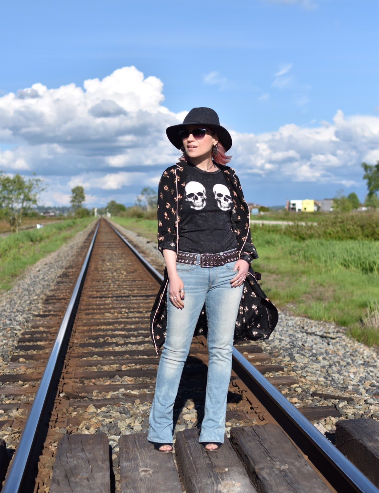 Monika Faulkner outfit inspiration - styling a skull t-shirt, floral shirtdress, flare jeans, and floppy hat