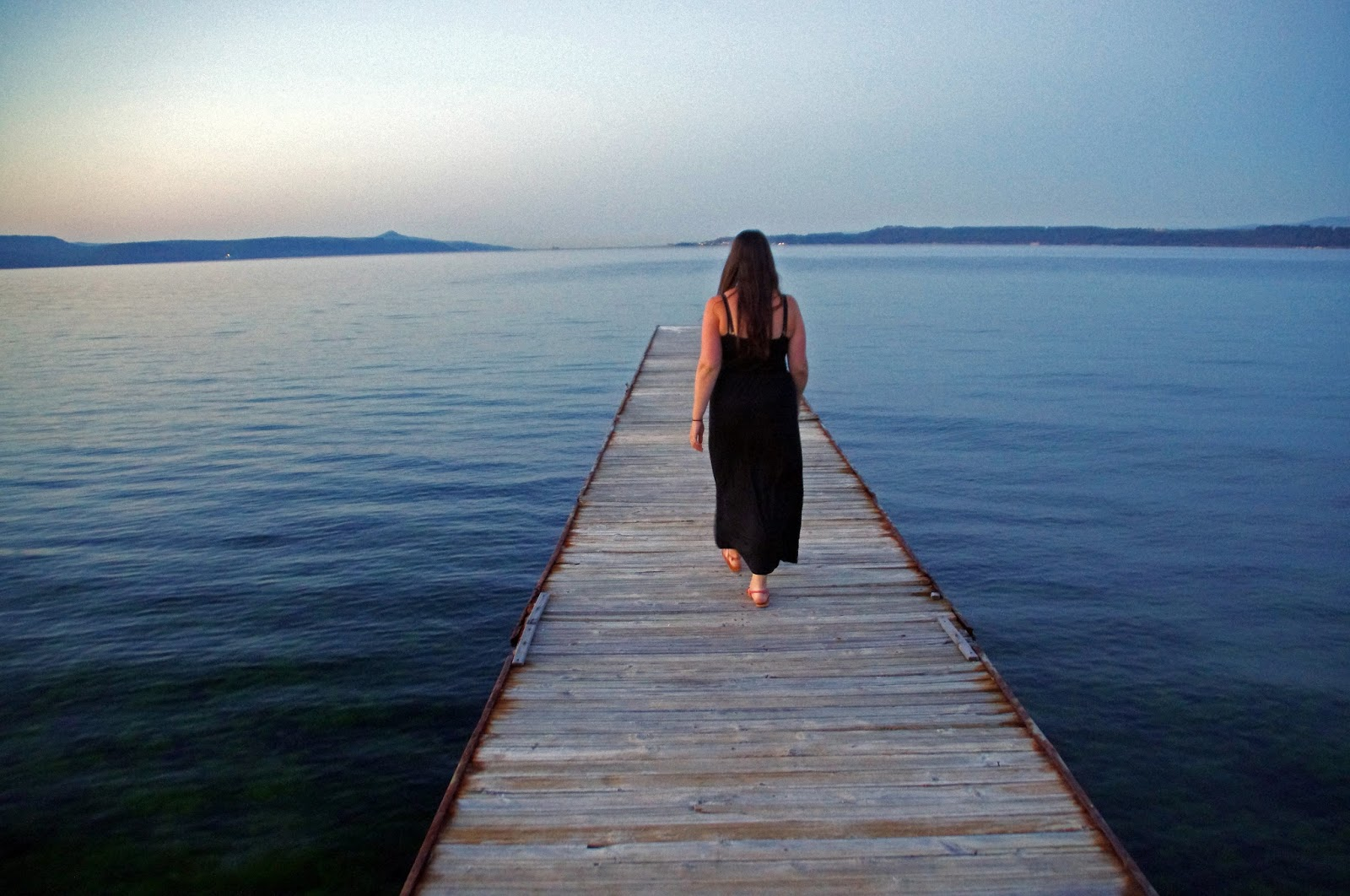 Girl walking on pier Eceabat Turkey