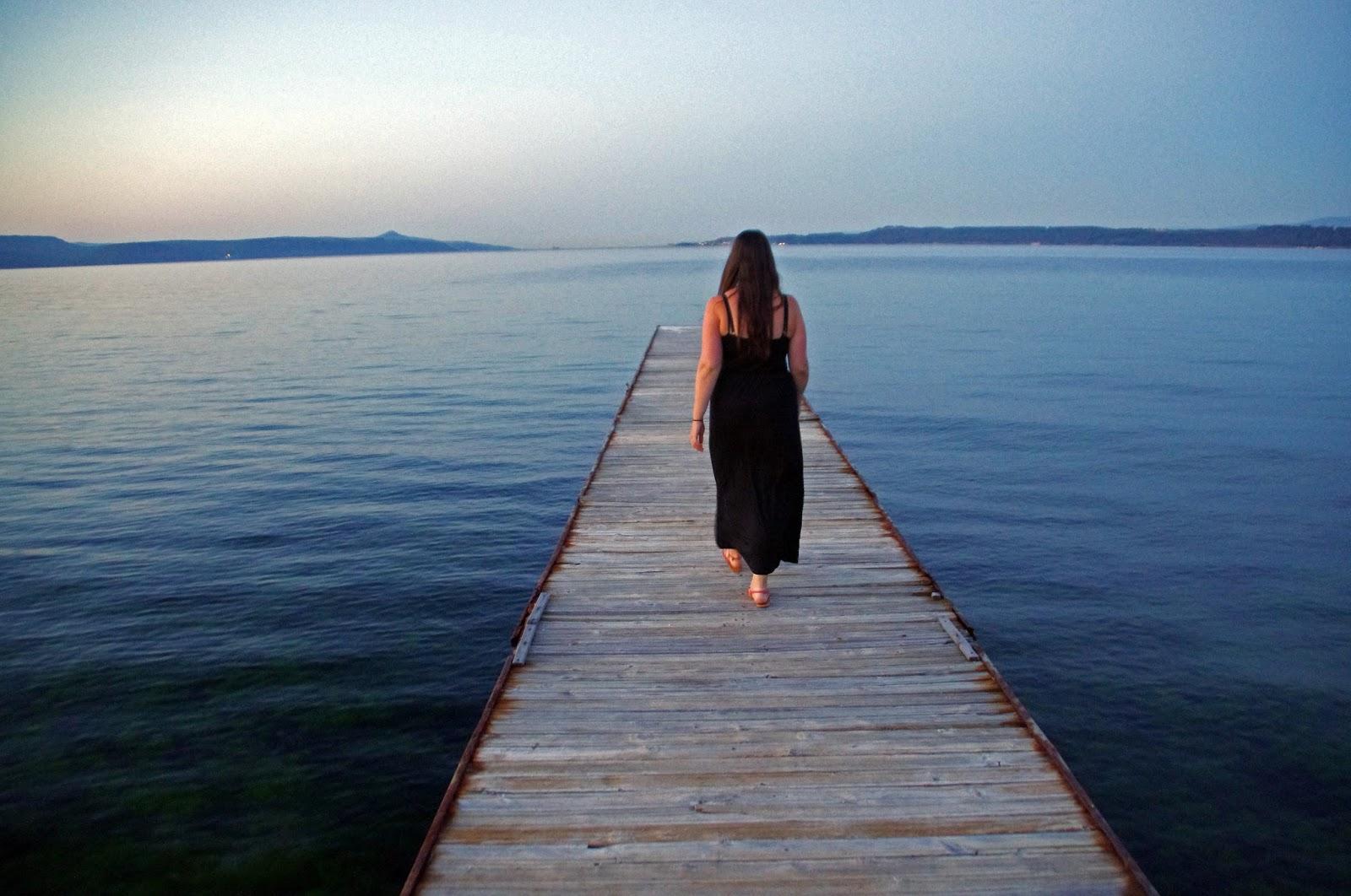 Girl walking on pier Eceabat Turkey