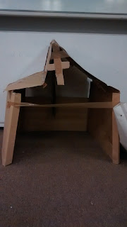 An anchorhold made from cardboard complete with roof and cross detail