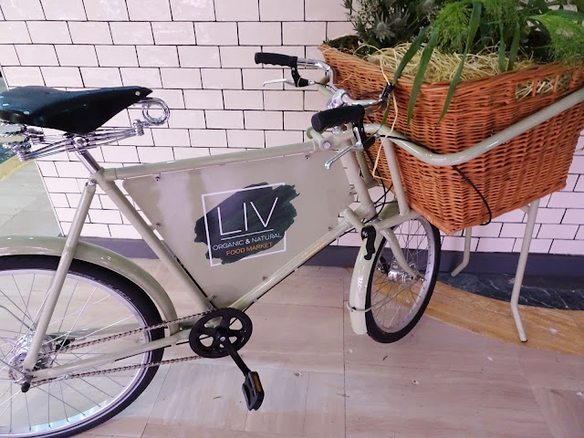 Decorative bicycle at entrance of LIV Organic and Natural Food Market