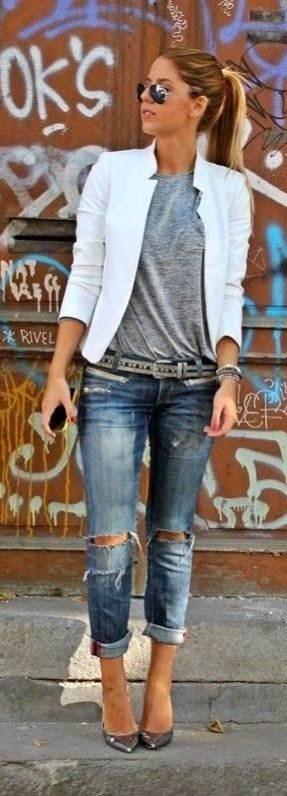 White jacket and ripped jeans look.
