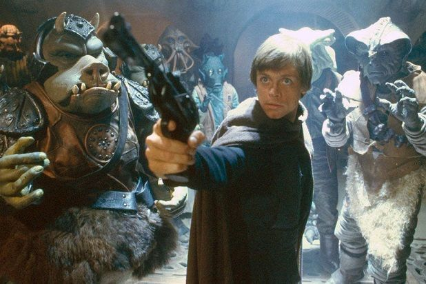 Luke Skywalker pointing a gun in Jabba's palace