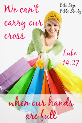 We can't carry our cross when our hands are full